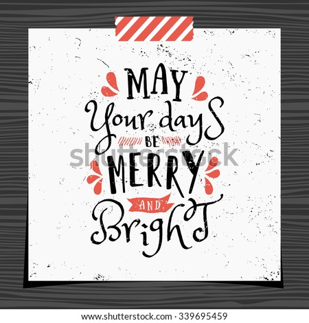 Christmas typographic design greeting card template. May Your Days be Merry and Bright message in black and red on white background. Christmas card with a strip of washi tape on dark wood background. - stock vector