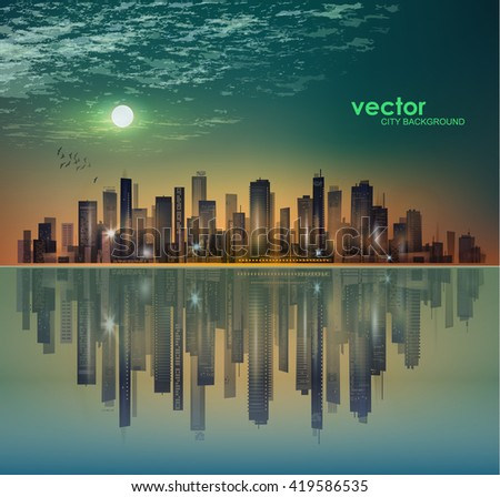 City skyline at night in moonlight or sunset, with reflection in water and cloudy sky