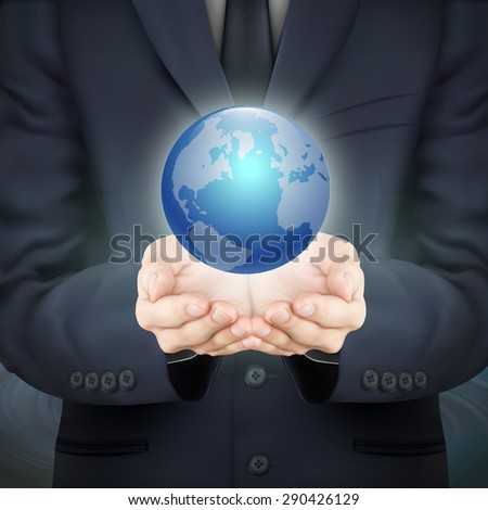 close-up look at businessman holding beautiful earth