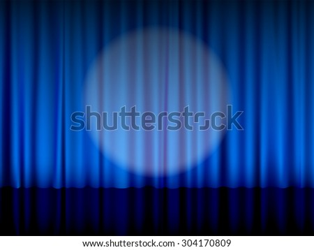 Close view of a blue theater curtain.