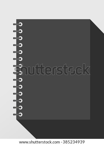 Closed black notepad notebook with spiral and long shadow on gray background