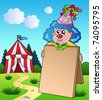 Clown holding board near tent - vector illustration. - stock photo