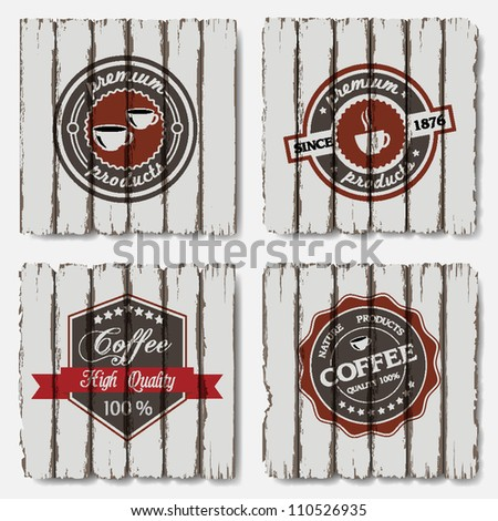 Coffee labels on old wood background.Vector set - stock vector