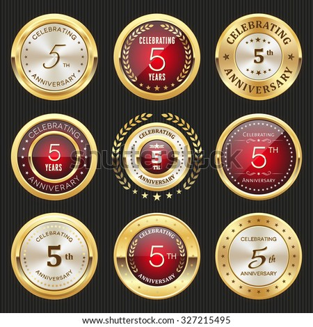 Collection of glossy gold and red 5th anniversary badges - stock vector