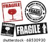 Collection of grunge office rubber stamps with word fragile written inside - stock vector