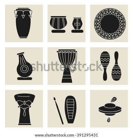 Collection of nine percussion instruments. Black silhouettes of conga, indian tablas, daf drum, maracas, djembe, udu, guiro,cymbals and doumbek. - stock vector
