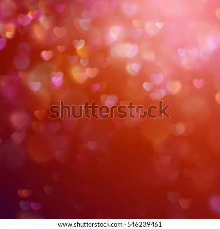 Color Bokeh on a red background with hearts.