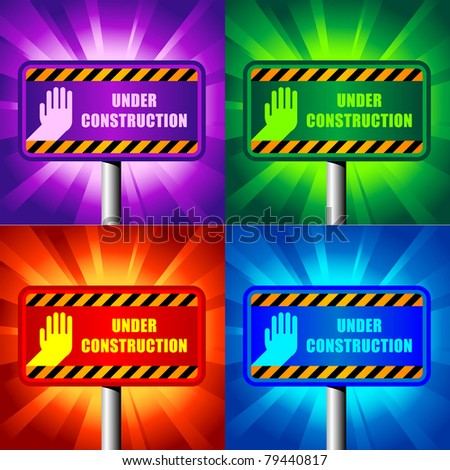 color under construction signs on shining backgrounds