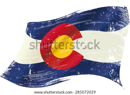 Colorado grunge flag. A flag of Colorado with a grunge texture in the wind - stock vector