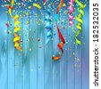 Colorful confetti on wooden background - stock photo