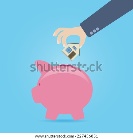 Concept about savings for house purchase. Hand throwing the small icon of home in the piggy bank.