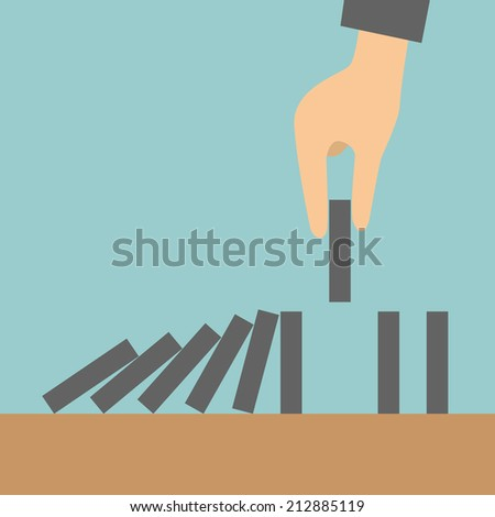 Concept businessman hand stopping the domino effect