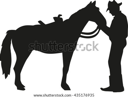 Cowboy talking to his horse silhouette