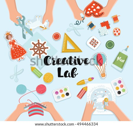 creative kids lab top view table with creative kids hands cutting paper painting