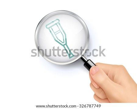 crutch icon showing through magnifying glass held by hand