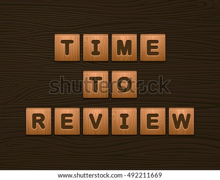 "Cubes with letters ""Time To Review"" on wooden board for Web"
