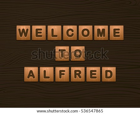 "Cubes with letters ""Welcome To Alfred"" on wooden board for Web"