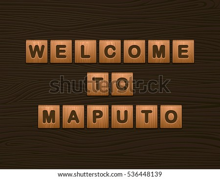 "Cubes with letters ""Welcome To Maputo"" on wooden board for Web"