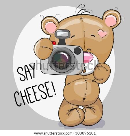 Cute cartoon Teddy Bear with a camera on a gray background - stock vector