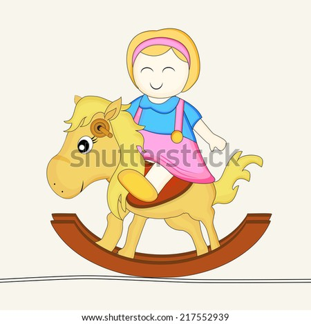 Cute little doll sitting on rock horse toy.