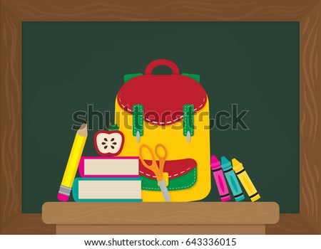 Cute school items in a flat style on a desk in front of a chalk board