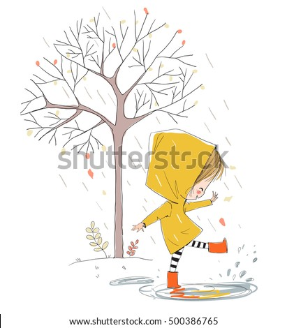 Cute smiling girl jumping in puddle. Theme autumn.