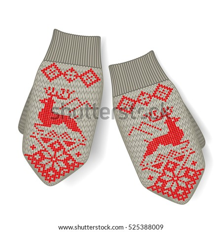 Cute wool mittens with Norwegian ornament. isolated