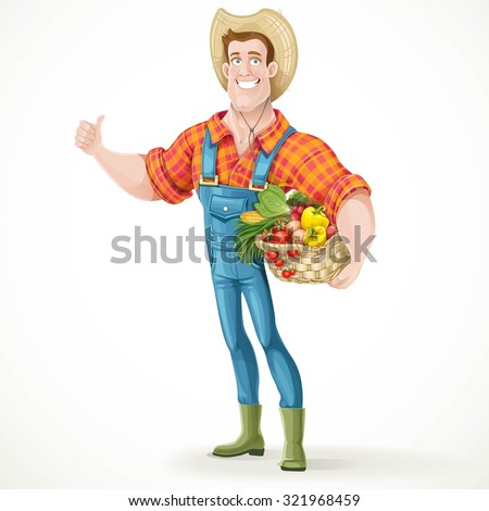 Cute young guy farmer with a big basket of vegetables showing thumbs up isolated on a white background
