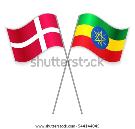 Danish and Ethiopian crossed flags. Denmark combined with Ethiopia isolated on white. Language learning, international business or travel concept.