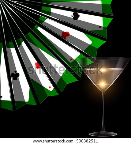 dark background with the black green fan with image of cards and the glass of bubbles wine