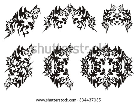Decorative cat head in tribal style. Set of vector cat head isolated on white. Tattoo, symbol, cat frame or element - stock vector