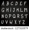 Decorative set of letters of the alphabet in uppercase or capitals in white on a black background - stock vector