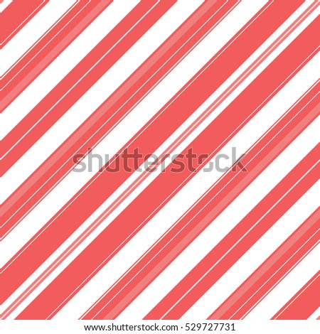 Diagonal stripe pattern background. Red and white colors. Winter holiday Christmas traditional candy pattern.
