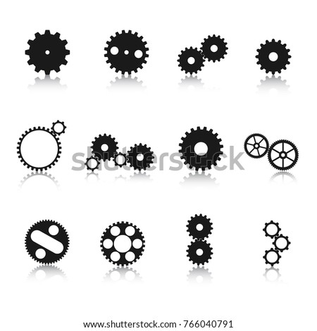 Different engineering gear wheel silhouettes with reflections