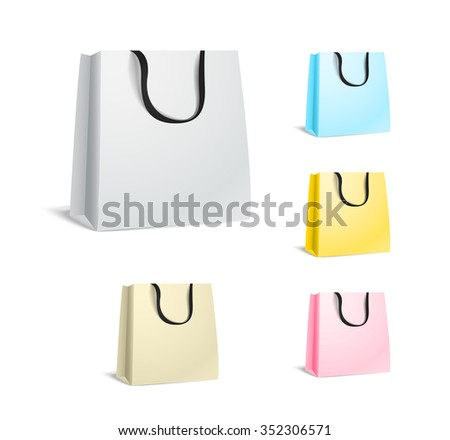 Different paper shopping bags isolated on white