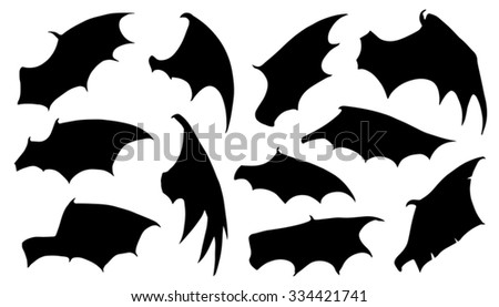 dragon wing silhouettes on the white background - stock vector
