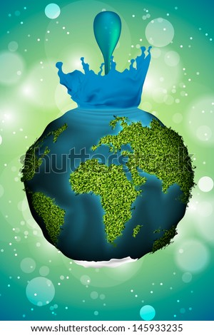 Earth with grass and water drop