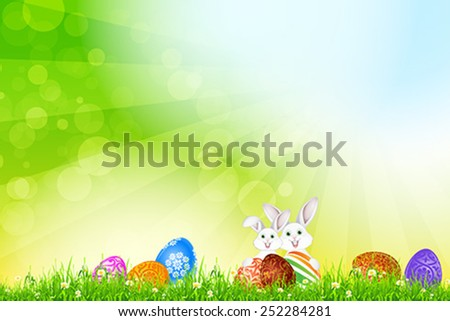 Easter Background with Flowers, Grass, Eggs and Two Rabbits