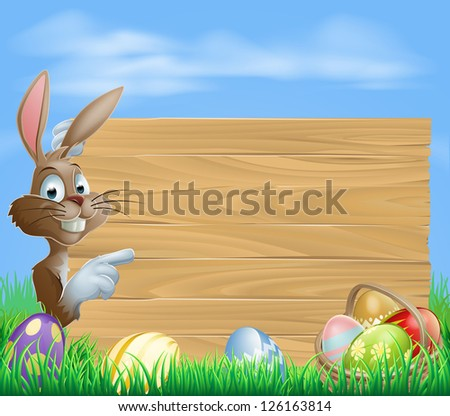 Easter bunny with Easter Eggs and blank wooden sign for your text