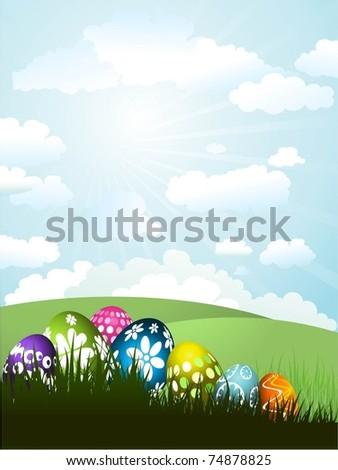 Easter eggs in grass in a sunny landscape