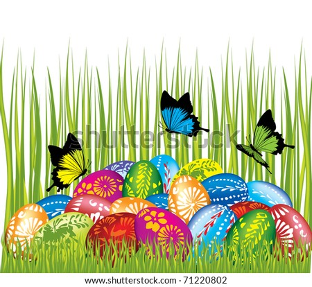 Easter eggs in the grass with butterflies