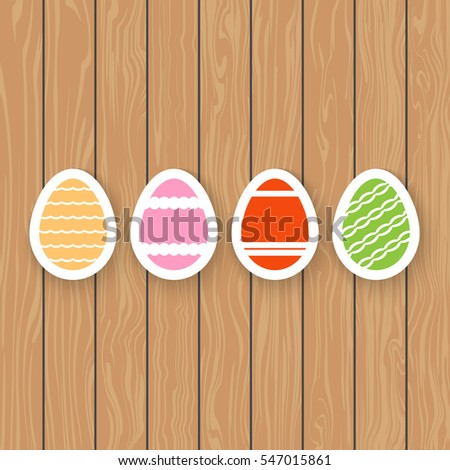 Easter eggs on a wooden background.
