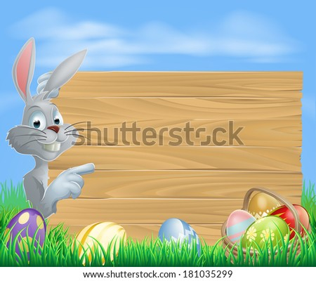 Easter white bunny rabbit pointing at a sign with a basket of chocolate Easter eggs