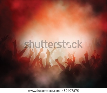 Editable vector illustration of a crowd of people in a smoky concert atmosphere created using gradient meshes