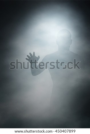 Editable vector illustration of a man reaching through fog created using gradient meshes - stock vector