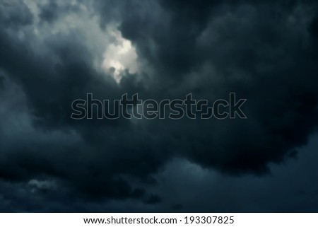 Editable vector illustration of dark heavy rainclouds made with a gradient mesh - stock vector