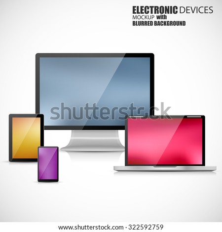 Electronic devices mockup set of laptop, tablet computer, monitor and smartphone with blurred background