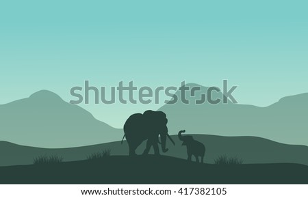 Elephant silhouette in fields with fog at morning - stock vector