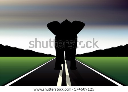 Eps 10 Editable vector silhouette of African elephant in walk pose on a road - stock vector