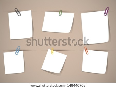 Eps10 vector : white note with colorful paper clips on retro brown board
